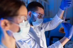 Close up of scientists making test in lab Stock Photography