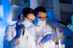 Close up of scientists making test in lab Royalty Free Stock Photos