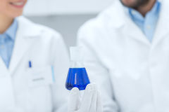 Close up of scientists with test tube in lab Royalty Free Stock Image