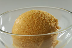 Close up of Scoop of delicious real fresh ice cream in Mango flavour. Stock Photography