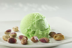 Close up of Scoop of delicious real fresh ice cream in Pistachio flavour. Royalty Free Stock Photo