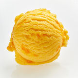 Close up on a scoop of tasty granadilla ice cream. Close up on a scoop of tasty orange Italian granadilla ice cream or gelato showing the creamy texture over Royalty Free Stock Photography