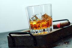 Close-up of scotch glass. Close-up image of a glass full of scotch and ice Royalty Free Stock Photos