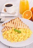 Scrambled egg and toast Stock Photography