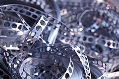 Close-up of scrap metal. From stamping production line, blue toned Stock Images