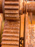 Close up on scraped rusted cogwheel Royalty Free Stock Photography