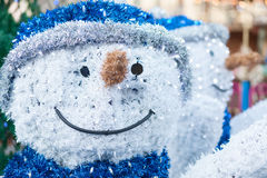 Close-up of a sculpture of a smiling snowman on a christmas mark Royalty Free Stock Photo