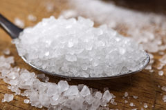 Close up of sea salt in stainless steel spoon Royalty Free Stock Photos