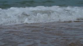 Close up of sea surf splashing stock footage