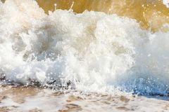 Close up of the sea water affecting the sand on the beach, sea w Royalty Free Stock Image