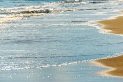 Close up of the sea water affecting the sand on the beach, sea w Stock Image