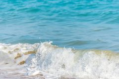 Close up of the sea water affecting the sand on the beach, sea w Stock Photography