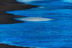 Close up of the sea water affecting the sand on the beach, sea w Stock Photo