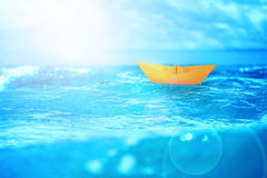 Close up sea water surface with yellow paper boat Royalty Free Stock Image