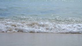 Close up sea wave and beach stock footage
