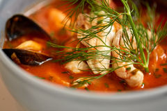 Close up of seafood soup with fish and mussels Stock Photography