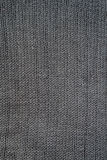 Close-up of seamless gray knitted fabric texture. Royalty Free Stock Photo