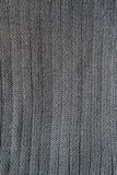 Close-up of seamless gray knitted fabric texture. Stock Image