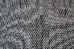 Close-up of seamless gray knitted fabric texture. Royalty Free Stock Photography