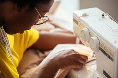 Close-up Seamstress Hands Working On Sewing Machine At Home Royalty Free Stock Photos