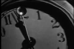 Close-up of second hand moving on clock face stock video