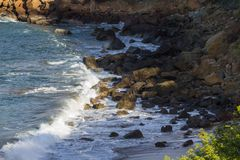 Waves at the beach. Close up of a section of beach in Playa Redonda, Nicaragua with waves crashing onto the rocks in this protected bay stock photo