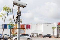 Security CCTV camera operating on the road and blurred of car pa stock images