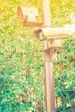 Close up of security surveillance camera . ( Filtered image proc Royalty Free Stock Image