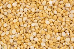 Husked brown gram pulse. Close up of seeds of husked brown gram pulse Stock Image