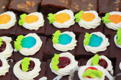 Close up of a selection of colorful donuts. Stock Images