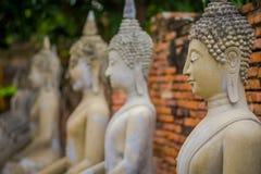 Close up of selective focus Ancient Buddha Statue at WAT YAI CHAI MONGKOL, The Historic City of Ayutthaya, Thailand.  Royalty Free Stock Image
