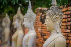Close up of selective focus Ancient Buddha Statue at WAT YAI CHAI MONGKOL, The Historic City of Ayutthaya, Thailand.  Royalty Free Stock Photo