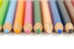 Close up selective focus of colorful color pencil stacked on whi Royalty Free Stock Photography