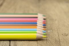 Close up selective focus of colorful color pencil stacked on woo Stock Photos
