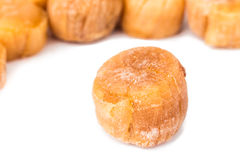 Close up and selective focus on dried Scallop at the foreground Stock Photos