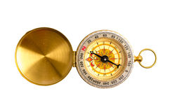 Close up, selective focus golden compass isolated on white backg Stock Photos