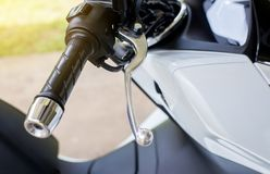 Close up of selective focus handlebars and front break on motorcycle. Close up of selective focus handlebars and front break on new motorcycle Stock Photo