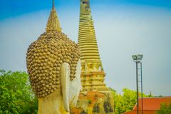 Close up of selective focus of the head of ancient Buddha Statue at WAT YAI CHAI MONGKOL, The Historic City of Ayutthaya. Thailand, in a blurred background Royalty Free Stock Photography