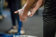 Close up selective focus of male hands preparing with chalk magnesium before exercise. Royalty Free Stock Images