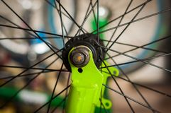 Close up of selective focus of the ring of the bike in a workshop.  Royalty Free Stock Photos