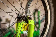 Close up of selective focus of the wheel of the bike in a workshop.  Stock Photo