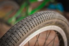 Close up of selective focus of the wheel of the bike in a workshop.  Royalty Free Stock Photos