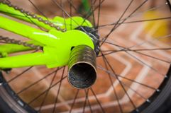 Close up of selective focus of the wheel of the bike in a workshop.  Royalty Free Stock Image