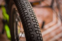 Close up of selective focus of the wheel of the bike in a workshop.  Stock Image