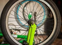 Close up of selective focus of the wheel of the bike in a workshop.  Stock Images