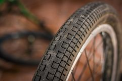 Close up of selective focus of the wheel of the bike in a workshop.  Royalty Free Stock Images