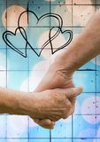 Close-up of senior couple holding hands. Against digitally generated background Stock Photography