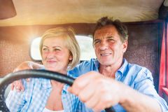 Close up of senior couple inside a pickup truck Stock Photos