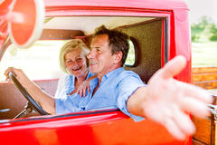 Close up of senior couple inside a pickup truck Royalty Free Stock Photography