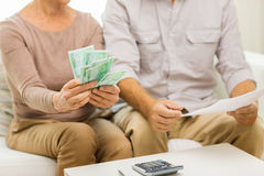 Close up of senior couple with money and bills Stock Photo